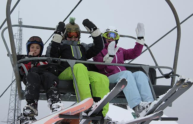 skiing is fun, good times, smiles, ski chairlift, fun times, smiles, Peak Leaders Morzine, happy skiers